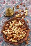 Nuts. Nut mix on a wooden plate Royalty Free Stock Images