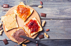 Nut nougat cream with chocolate , jam and peanut butter Royalty Free Stock Photo