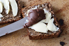 Nut-nougat-creme. On a bread Stock Image