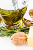 Nut and oil. Nut parmesan and olive oil on wooden cutting board Stock Images