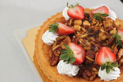 Nut pie ontop cream  and  fresh strawberry Royalty Free Stock Image