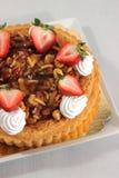 Nut pie ontop cream  and  fresh strawberry Stock Image