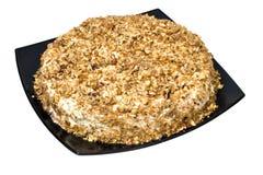Nut pie. Pie posyranny a nut crumb on a black dish Stock Photography
