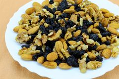Nut-raisin chaos in a white plate royalty free stock photo