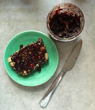 Nut and seed bread on plate with blackcurrant jam. A slice of vegan, paleo-friendly, gluten-free nut and seed bread has been toasted and placed on a green Royalty Free Stock Photos