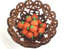 Nut shell bowl with pumpkin candies Royalty Free Stock Photo