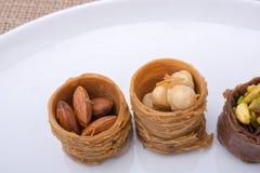 Nut stuffed dessert of mini size cuisine Royalty Free Stock Images