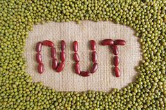 Nut text made by group of beans and lentils Royalty Free Stock Photography