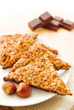 Nut triangles. German pastry called Nussecken, consisting of nut cake covered with chocolate Royalty Free Stock Photography