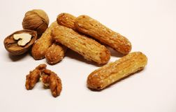 Nut. Walnuts. Biscuit. Sugar sticks with nuts. Biscuits and nuts. Dessert. Bakery products. Stock Images