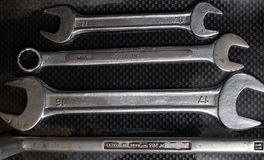 Nut wrenches on a reflective carbon fiber surface Royalty Free Stock Photo