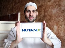 Nutanix software company logo. Logo of Nutanix software company on samsung tablet holded by arab muslim man. Nutanix is a cloud computing software company that stock photo