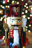 Nutcracker. Wooden nutcracker in front of Christmas tree Royalty Free Stock Photos