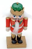 Nutcracker. A red and green holiday soldier nutcracker on a white background stock images