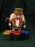 Nutcracker. Toy Christmas nutcracker and gifts Stock Photography