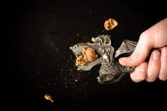 Nutcracker. Break nuts with nutcracker on a black background Stock Image