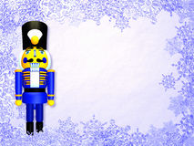 Nutcracker. On a purple snowflakes background Stock Photos