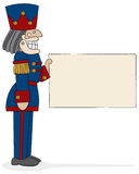 Nutcracker Captain. A traditional military-style nutcracker holding a sign waiting for your message. Hand-drawn in loose style with charcoal outline and painted Royalty Free Stock Photography