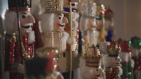 Nutcracker in a christmas decoration. Near the tree with many lights stock footage