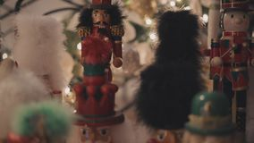 Nutcracker in a christmas decoration. Near the tree with many lights stock video