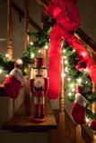 Nutcracker by Christmas garland Royalty Free Stock Images