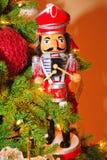 Nutcracker figure. Traditional nutcracker figure by Christmas tree Stock Image
