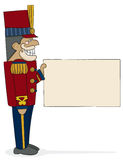 Nutcracker General. A traditional military-style nutcracker holding a sign waiting for your message. Hand-drawn in loose style with charcoal outline and painted Royalty Free Stock Photography