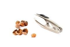 Nutcracker with hazelnut isolated on white Royalty Free Stock Image