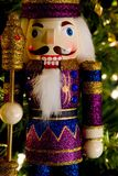 Nutcracker king, wood toy. Nutcracker king decoration standing by a christmas tree Royalty Free Stock Photography
