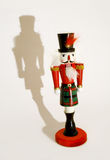 Nutcracker limelight. Dramatic lighting on a traditional wooden Christmas Nutcracker ornament Royalty Free Stock Image