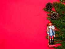 Nutcracker on red background. Stock Photo
