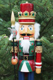 Nutcracker soldier and christmas tree as a background Royalty Free Stock Photography