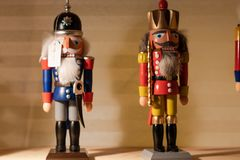 Nutcracker standing on a shelf. wooden figures, christmas, symbol; stock photo