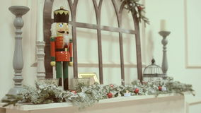Nutcracker toy , standing on the mantelpiece stock video footage