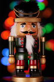 Nutcracker. Traditional wooden Nutcracker on multicolored background Royalty Free Stock Images