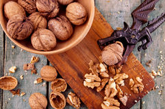 Nutcracker with walnuts. On wooden table Stock Photos