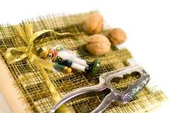 Nutcracker, walnuts and decorations Royalty Free Stock Photo