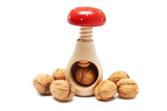 Nutcracker and walnuts isolated on white Royalty Free Stock Images