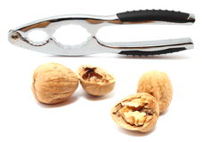 Nutcracker with walnuts isolated on white. A nutcracker with three walnuts (cracked or still closed) isolated on white Stock Images