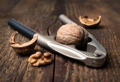 Nutcracker and walnuts Royalty Free Stock Photos