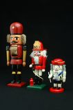 Nutcrackers. Three German nutcrackers on a black background Royalty Free Stock Photos