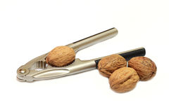 Nutcrackers. In use on a walnut royalty free stock image