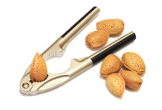 Nutcrackers with almonds. Nutcrackers in use on almonds royalty free stock photography