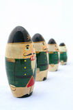 Nutcrackers at Attention 1. Russian Christmas nesting nutcrackers lined up in descending order. Isolated and selective focus on the closest one royalty free stock photography