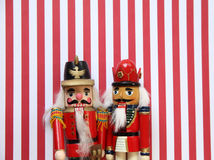 Nutcrackers on red and white stripes Royalty Free Stock Photos
