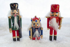 Nutcrackers in the Snow. Three Nutcrackers in a Christmas Snow Scene Stock Photography