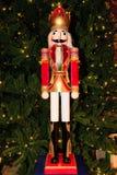 Nutcrucker figure. Traditional nutcrucker figure by Christmas tree Stock Images