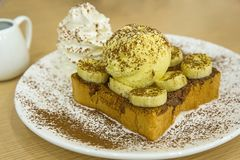 Nutella banana French Toast with ice-cream, sprinkle with cocoa powder stock photo