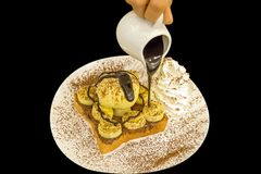 Nutella banana French Toast with ice-cream, sprinkle with cocoa powder royalty free stock photography