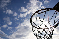Nuthin' but net. Silhouette of a basketball hoop against a brilliant sky Stock Photos